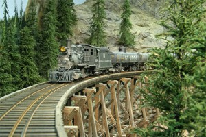 C-16 268 is in charge of a tank train as it crosses Dry Gulch trestle